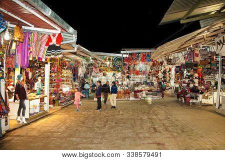 Machu Picchu Pueblo,  Peru - Jan 7, 2019:  Night Market at  Machu Picchu Pueblo or Aguas Calientes town, Peru. South America.