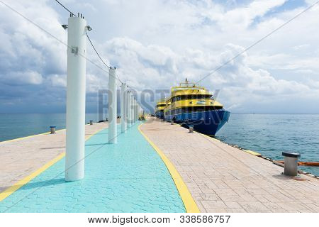 Playa Del Carmen, Mexico - November 13, 2019:  High Speed Ferries Line The Playa Del Carmen Pier.  T