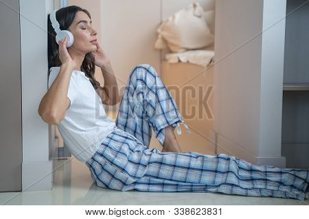 Relaxing At Home With Favorite Music Stock Photo