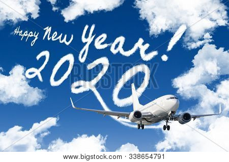 Drawing By Airplane Vapor Steam Contrail In Blue Sky. Happy New Year Concept