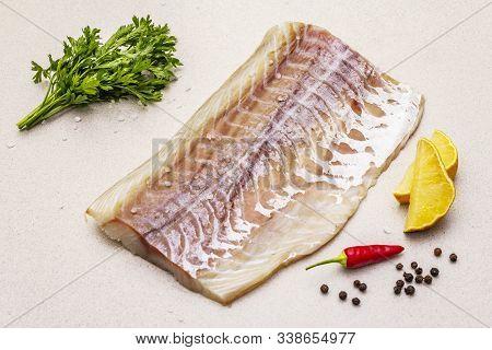 Raw Pollock (pollachius Virens) Fillet. Fresh Fish For Healthy Food Lifestyle. Lemon, Parsley, Sea S
