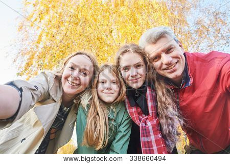 Happy family with children outdoors