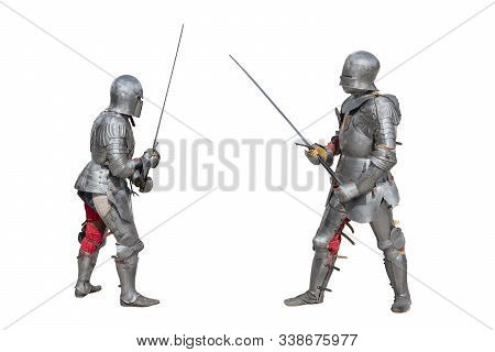 Knights In Armor. Medieval Knights In Iron Armor Hold Swords In Their Hands. Duel Of The Medieval Wa