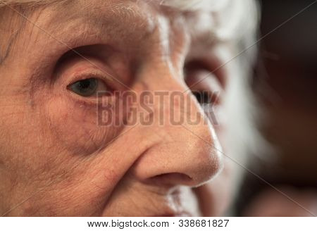An Elderly Woman Feeling Cold At Her Home During The Winter Months.