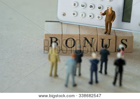 Miniature People: Boss Calculate Earnings Profits Of The Business For Pay Bonus To Staff In Annual.