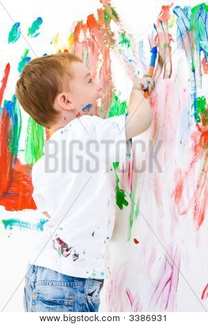Child Painting A White Wall