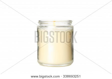 Yellow Burning Candle In Glass Jar Isolated On White Background