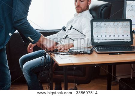 Your Fingers Please. Preparation For The Polygraph Test. Conception Of The Lie Detector.