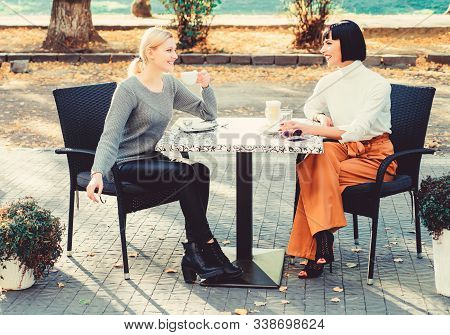 Trust Her. Girls Friends Drink Coffee And Enjoy Talk. True Friendship Friendly Close Relations. Conv