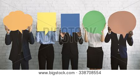 Business Opinion Concept. Group Of Corporate People Hiding Faces Behind Blank Speech Bubbles, Empty