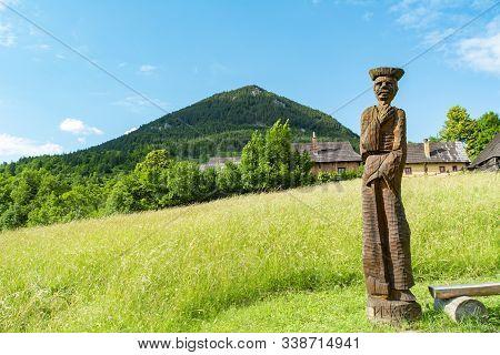 Vlkolinec, Ruzomberok / Slovakia - June 17, 2018: Wooden Statue Of A Villager In The Mountain Villag