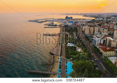 Limassol Promenade At Sunset, Cyprus. Aerial Panoramic View Of Evening Limassol With Molos Park From