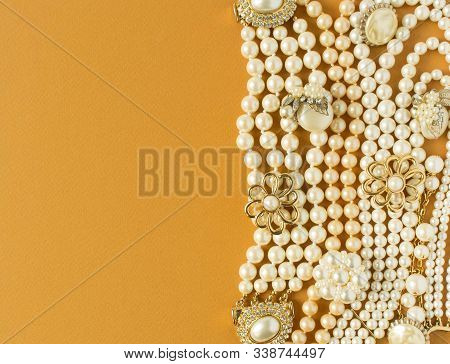 Pearls Background. Woman's Jewelry. Vintage Jewelry Background. Beautiful Gold Tone And Pearls Brooc