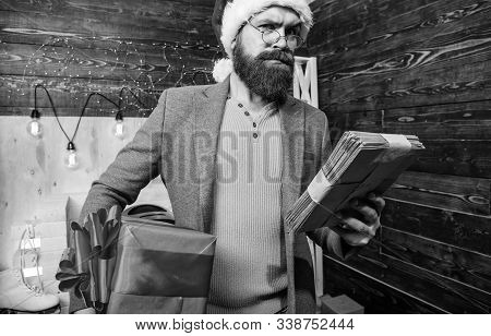 Post For Santa Claus. Man Bearded Hipster Wear Santa Hat Hold Bunch Of Letters And Gift Box. Gifts D