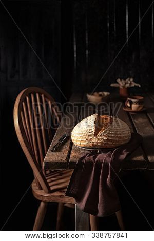 Mixed Flour Country Bread On A Wooden Rustic Table