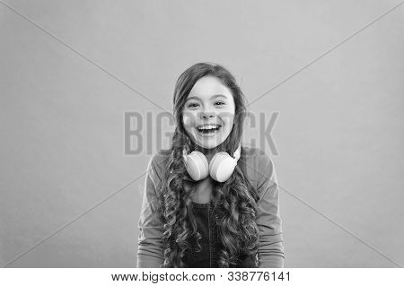 Drift Into The Music. Happy Little Dj On Blue Background. Cute Girl Smiling With Dj Headphones. Smal
