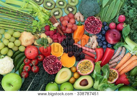 Healthy heart food concept with fruit, vegetables, herbs and spices. Health foods high in fibre, antioxidants, anthocyanins, vitamins, omega 3 and protein to support the cardiovascular system. Low gi.