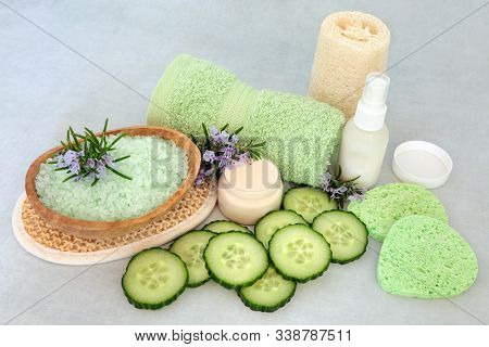 Natural vegan skincare beauty treatment with fresh rosemary herb, cucumber, ex foliation salts, moisturising creams & cleansing products. Health care concept.