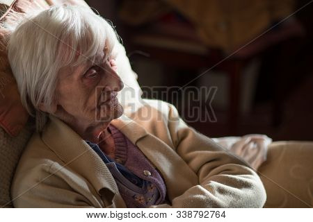 An Elderly Woman Feeling Isolated,alone And Cold At Her Home During The Winter Months.