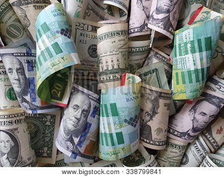 Israeli Banknotes And American Dollar Bills Unorganized