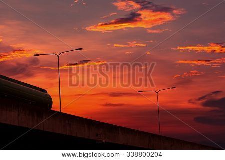 Bottom View Of Elevated Concrete Highway With Sunset Sky. Overpass Concrete Road. Road Flyover Struc