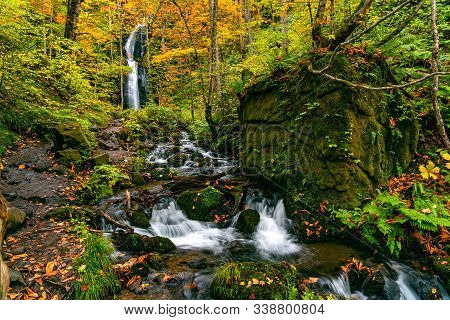 View Of Komoi No Tagi Waterfall In Autumn Season At Oirase Gorge With The Colorful Foliage Forest An