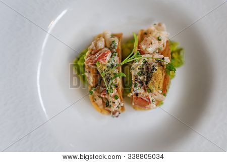 Lobster Tacos Dorados On A Plate At A Luxury Restaurant, Served With Cilantro Sprouts And Mashed Avo
