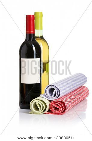 Bottle of red and white wines from the napkins on white background