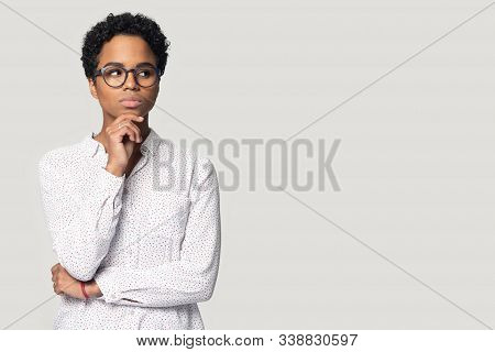 Young Pensive Ethnic Woman Looking Aside On Empty Copy Space.