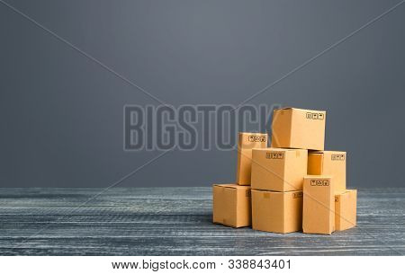 Cardboard Boxes Pile. Production Goods And Products, Distribution And Trade Exchange Goods, Retail S