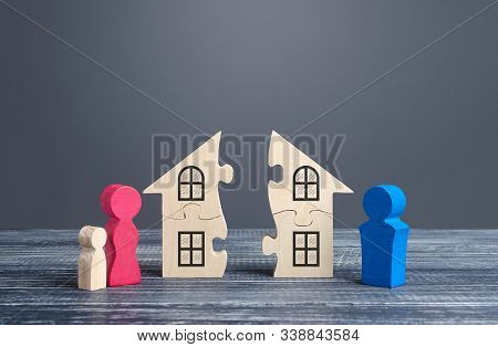 Husband And Wife Divide A House In A Divorce Process. Disputes Over Division Of Real Estate And Prop