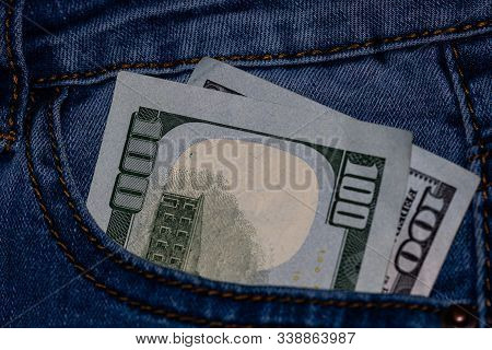 Banknotes, Money In A Jeans Pocket, Close Up. Money Stick Out Of The Jeans Pocket, Finance And Curre