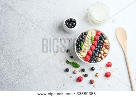 Healthy Breakfast. Oatmeal With Berries And Fruits And Milk On A Light Background Copy Space.