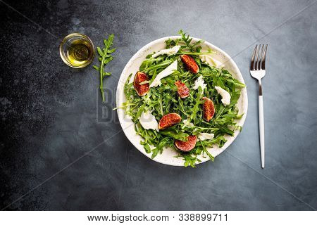 Delicious Salad With Figs, Arugula And Goat Cheese On White Plate, Top View, Copy Space