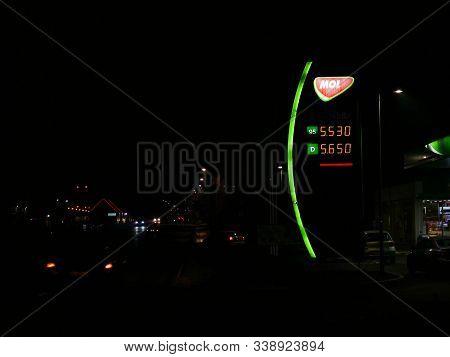 Miercurea Ciuc, Romania- 11 December 2019: Mol Gas Station At Night, Passing Cars In The Dark.