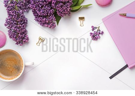 Creative Composition With Feminine Accessories, Beautiful Lilac Flowers, Coffee And Macarons