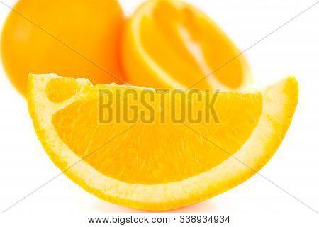 Selective Focus Of Fresh Juicy Orange Lobule Isolated On White