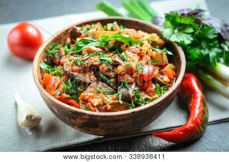 Vegetable Saute Or Caponata, Or Pisto With Eggplant, Peppers, Tomatoes And Herbs In Rustic Bowl On A