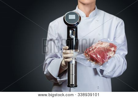 Concept Of Cooking Meat In The Sous Vide Technology. Shows Cook Sous Vide Immersion Circulator Cooke