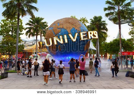 Singapore-november 28, 2019: Tourists And Theme Park Visitors Taking Pictures Of The Large Globe In