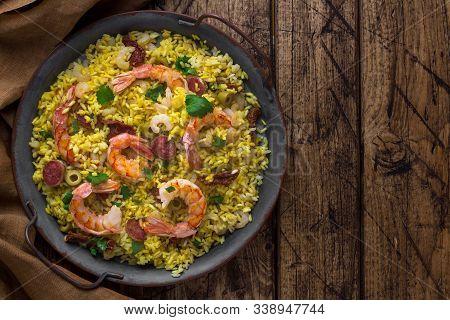 Paella With Yellow Rice, Shrimps, Chorizo And Sun-dried Tomatoes