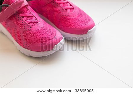 Modern Pinky Sport Shoes .pair Of Sport Shoes On Colorful Background. New Sneakers On Soft Green Bac