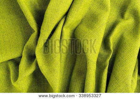 Wave Green Natural Linen Fabric Textile Material Texture As A Background. Green Textile Pattern For