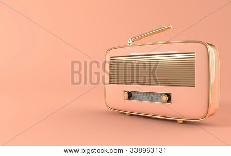Vintage Style Radio Receiver On Pink Background. Pastel Colors And Golden Details. Retro Radio Reali