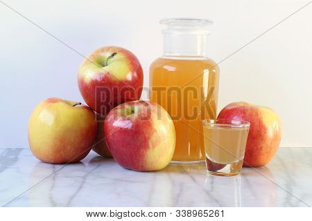Apple Cider Vinegar Bottle With Shot Glass And Fresh Apples. Copy Space.