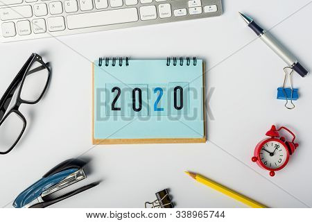 2020 Year - Text On Notebook. New Year 2020 Beggining - Business Concept