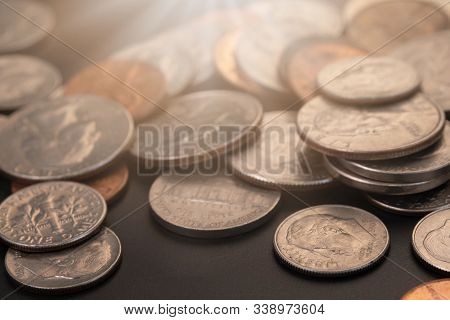 Money, Us Dollars Bank Notes, Penny, Nickel, Dime, Quarter On Black Background. Finance And Economy