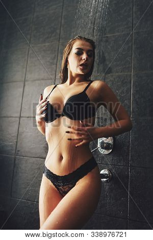 A Beautiful Girl Is Standing In The Shower. Wet Photo Shoot