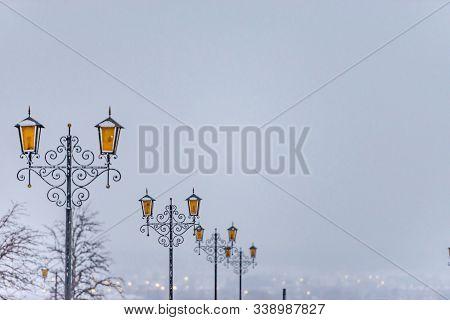 Elabuga. Wrought Iron Street Lights On The Hill. Orange Glass On The Lights.