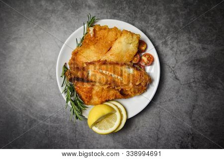 Fried Fish Fillet Sliced For Steak Or Salad Cooking Food With Herbs Spices Rosemary And Lemon / Tila